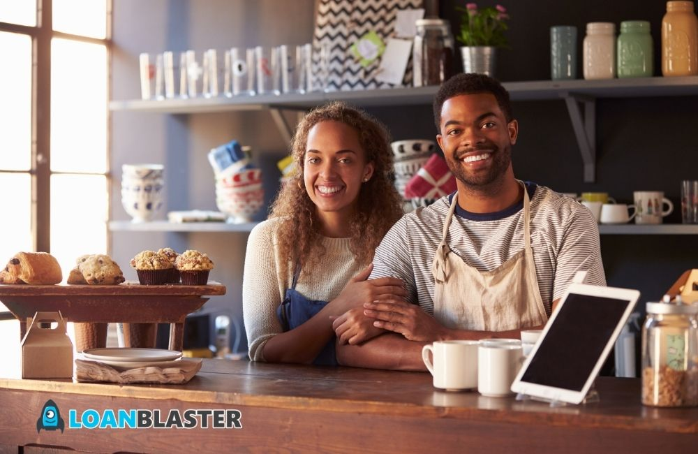 happy small business owners in a restaurant
